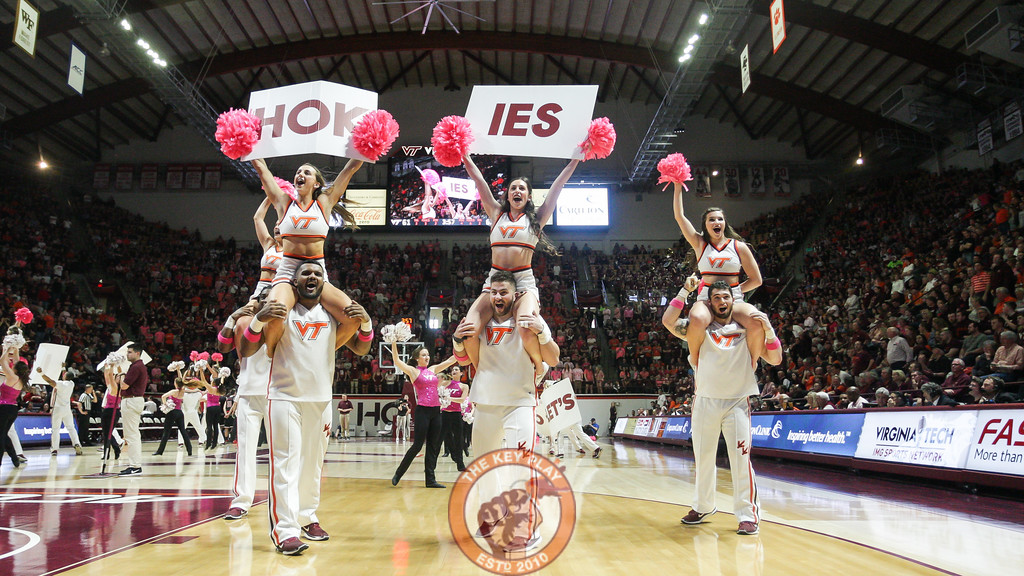 The Virginia Tech Cheerleaders lead the crowd in a cheer during a media timeout. (Mark Umansky/TheKeyPlay.com)