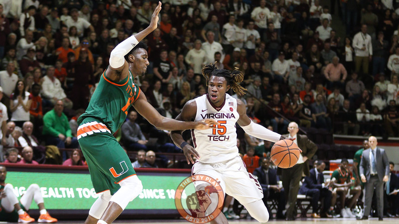 Chris Clarke dribbles the ball towards the Miami basket in the second half. (Mark Umansky/TheKeyPlay.com)