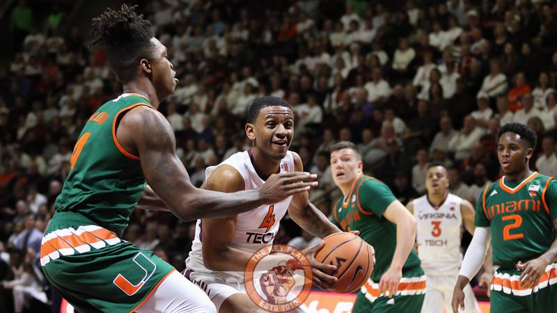 Nickeil Alexander-Walker picks up his dribble on a drive to the basket. (Mark Umansky/TheKeyPlay.com)