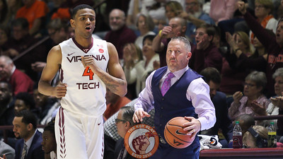 Head coach Buzz Williams grabs the ball after it landed out of bounds in the first half. (Mark Umansky/TheKeyPlay.com)