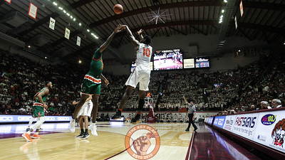 Justin Bibbs attempts a heavily guarded corner three in the second half. (Mark Umansky/TheKeyPlay.com)