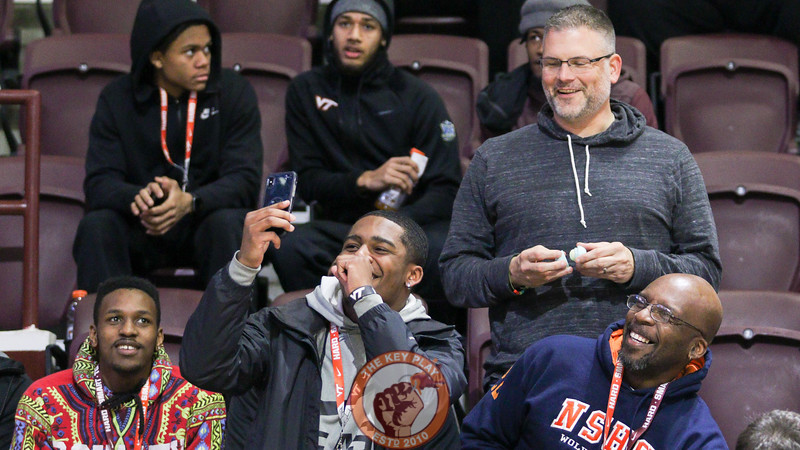 Hokies head football Coach Justin Fuente hangs out with football recruit Devyn Wilson on an official visit that included seats at the men's basketball game. (Mark Umansky/TheKeyPlay.com)
