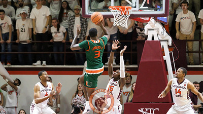 Miami's Anthony Lawrence attempts to float a shot over Chris Clarke late in the second half to extend Miami's lead. (Mark Umansky/TheKeyPlay.com)
