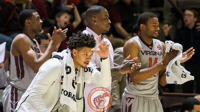 Tyrie Jacson holds up an L after an NC State turnover turned into a Virginia Tech fast break. (Mark Umansky/TheKeyPlay.com)