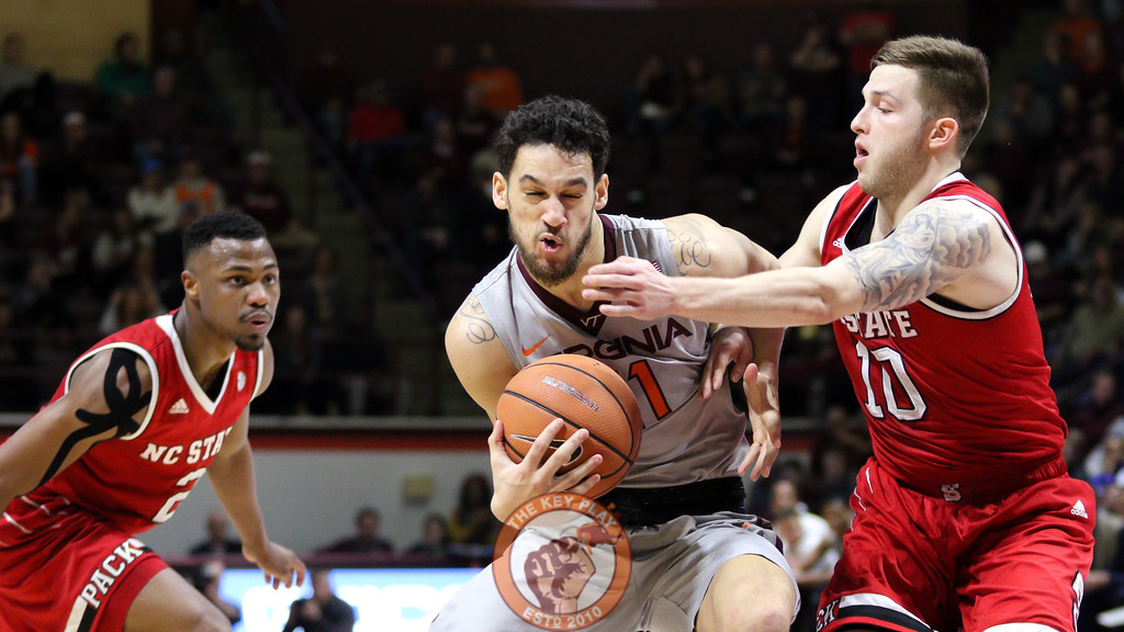 Devin Wilson is fouled hard on a drive to the basket in the first half. (Mark Umansky/TheKeyPlay.com)