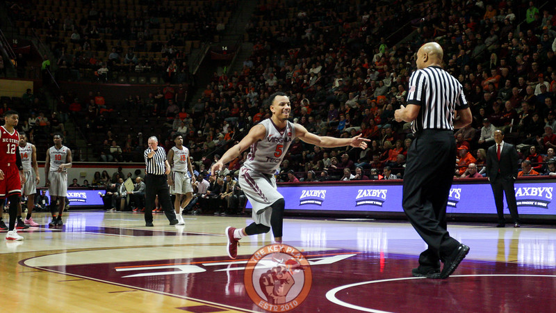 Justin Robinson high fives invisible teammates after a technical free throw attempt in the first half. (Mark Umansky/TheKeyPlay.com)