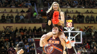 The Virginia Tech Cheerleaders perform for the crowd during a media timeout. (Mark Umansky/TheKeyPlay.com)