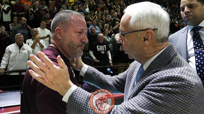 UNC head coach Roy Williams (right) congratulates Virginia Tech head coach Buzz Williams (left) after the Hokies run out the clock for the victory. (Mark Umansky/TheKeyPlay.com)