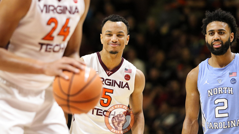 Justin Robinson (5) smiles during a short break in the action before a free throw attempt. (Mark Umansky/TheKeyPlay.com)
