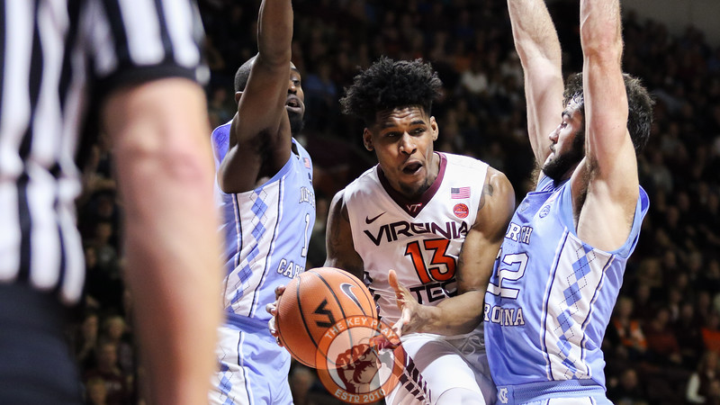Ahmed Hill draws two UNC defenders as he looks to pass from underneath the basket in the second half. (Mark Umansky/TheKeyPlay.com)