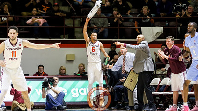 Justin Robinson tries to keep the crowd amped up from the bench during a Virginia Tech defensive set. (Mark Umansky/TheKeyPlay.com)