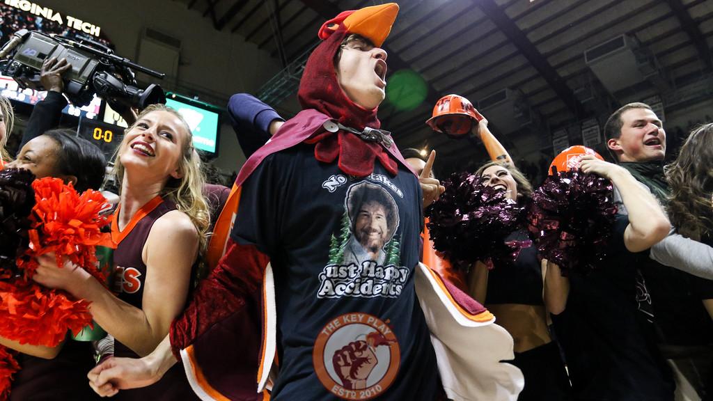 Fans storm the court inside Cassell Collesium after Virginia Tech defeats #10 UNC 80-69. (Mark Umansky/TheKeyPlay.com)