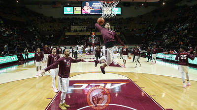 Tyrie Jackson floats underneath the basket before a dunk during pre-game warmups. (Mark Umansky/TheKeyPlay.com)