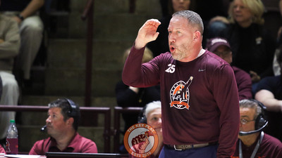 Buzz Williams signals for a defensive setup as UNC begins a posession. (Mark Umansky/TheKeyPlay.com)