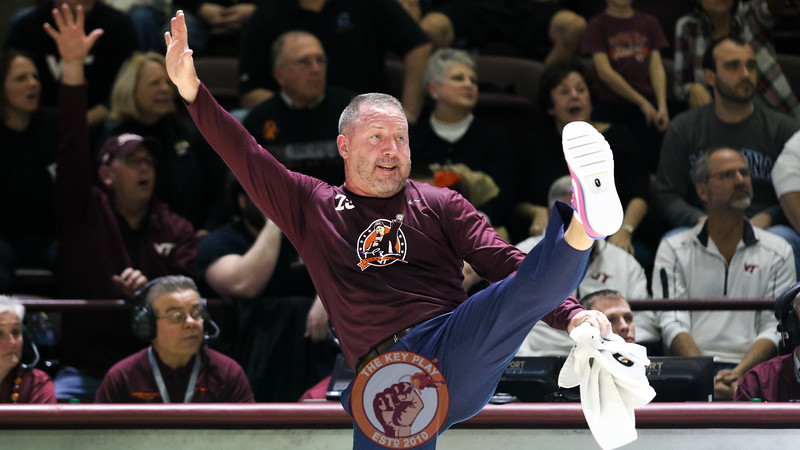 Head coach Buzz Williams kicks a leg in the air as he reacts to his players successfully defending the Hokies' basket. (Mark Umansky/TheKeyPlay.com)
