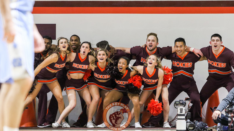 The Virginia Tech Cheerleaders huddle up right before the beginning of the second half. (Mark Umansky/TheKeyPlay.com)