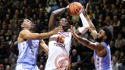 Chris Clarke splits a pair of UNC defenders on a drive to the basket. (Mark Umansky/TheKeyPlay.com)