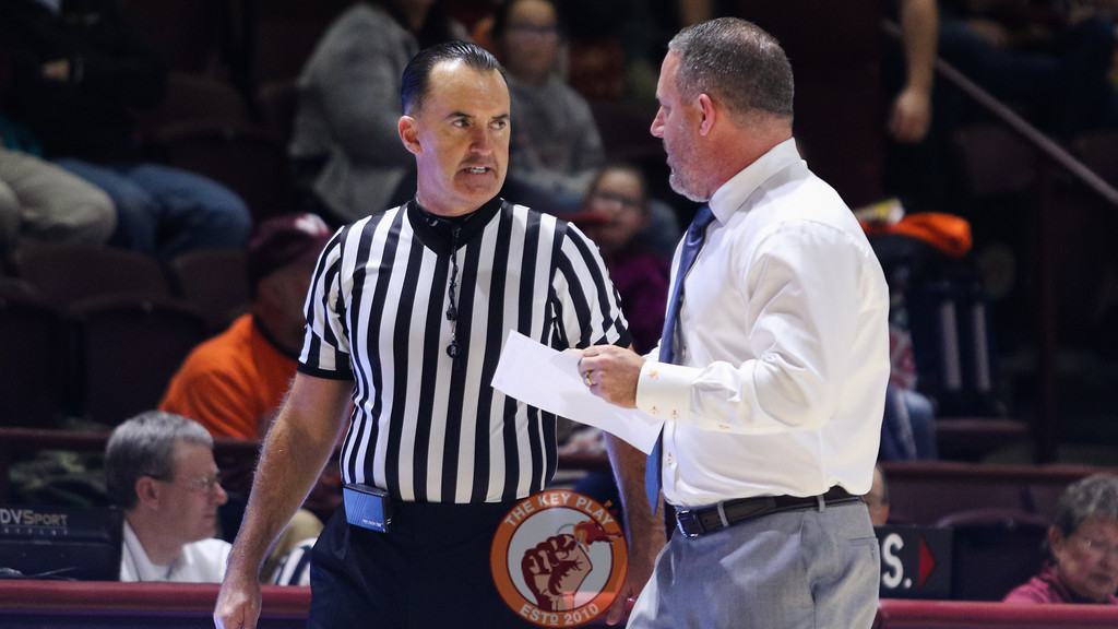 Referee Roger Ayers speaks with Virginia Tech head coach Buzz Williams after calling a technical foul on him after complaining about a call. (Mark Umansky/TheKeyPlay.com)