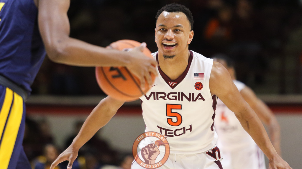 Justin Robinson smiles as he gets set up on defense in the second half. (Mark Umansky/TheKeyPlay.com)
