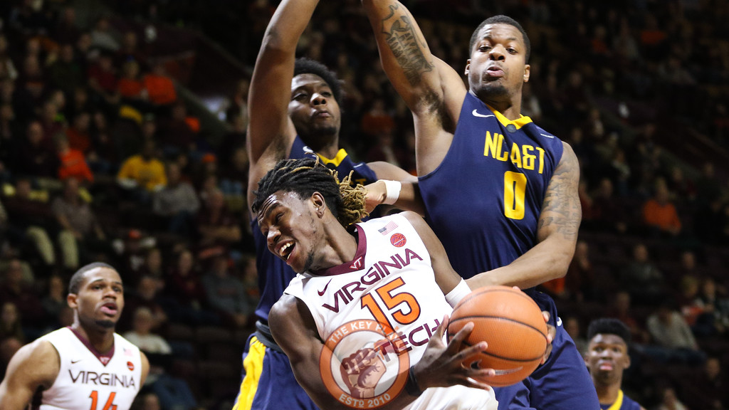 Chris Clarke is fouled underneat the NC A&T basket on a layup attempt late in the game. (Mark Umansky/TheKeyPlay.com)