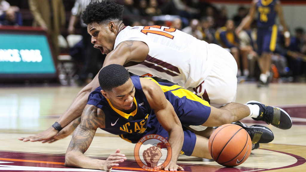Virginia Tech's Ahmed Hill and NC A&T's Devonte Boykins fight for a loose ball near the NC A&T basket. (Mark Umansky/TheKeyPlay.com)