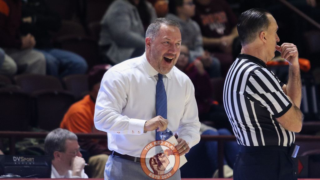 Hokies Head coach Buzz Williams jokes with referee Roger Ayers during the second half of the game. (Mark Umansky/TheKeyPlay.com)
