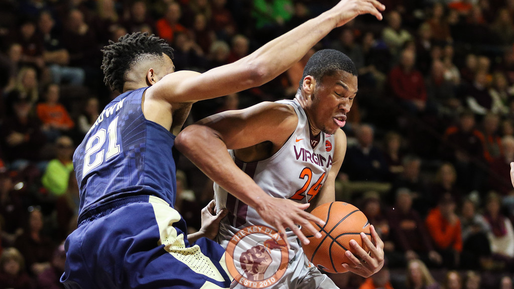 Kerry Blackshear Jr. is heavily guarded underneath the Pittsburgh basket late in the second half. (Mark Umansky/TheKeyPlay.com)