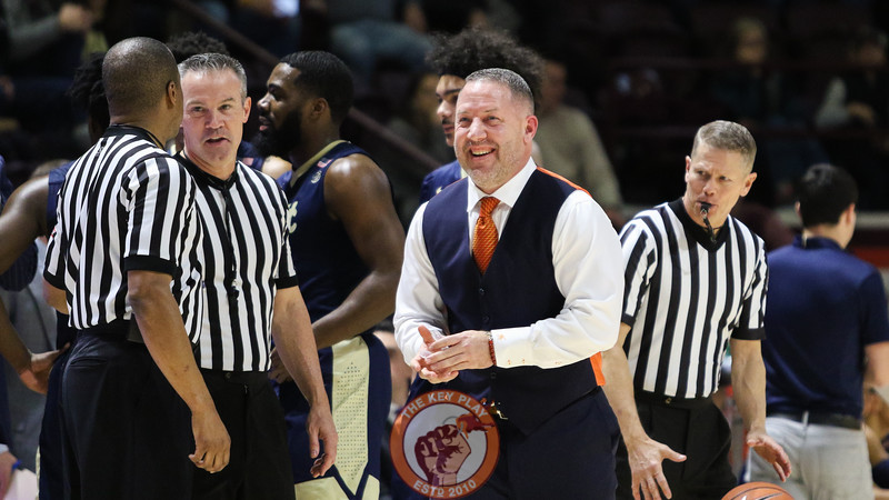 Head coach Buzz Williams smiles after a quick chat with Pittsburgh head coach Kevin Stallings following a pause in the game after a foul. (Mark Umansky/TheKeyPlay.com)