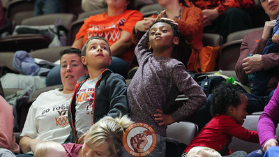 A young fan in the stands dances during a break in the action. (Mark Umansky/TheKeyPlay.com)