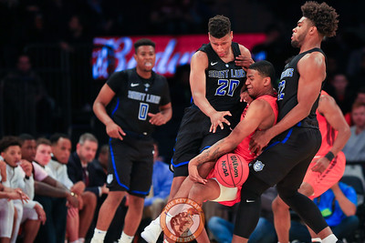 Virginia Tech's guard Nickeil Alexander-Walker (4) is defended heavily by St. Louis' forward Jalen Johnson (20) and forward Hasahn French (22) in Madison Square Garde, Nov. 16, 2017. St. Louis upset Virginia Tech with a 77-71 win.