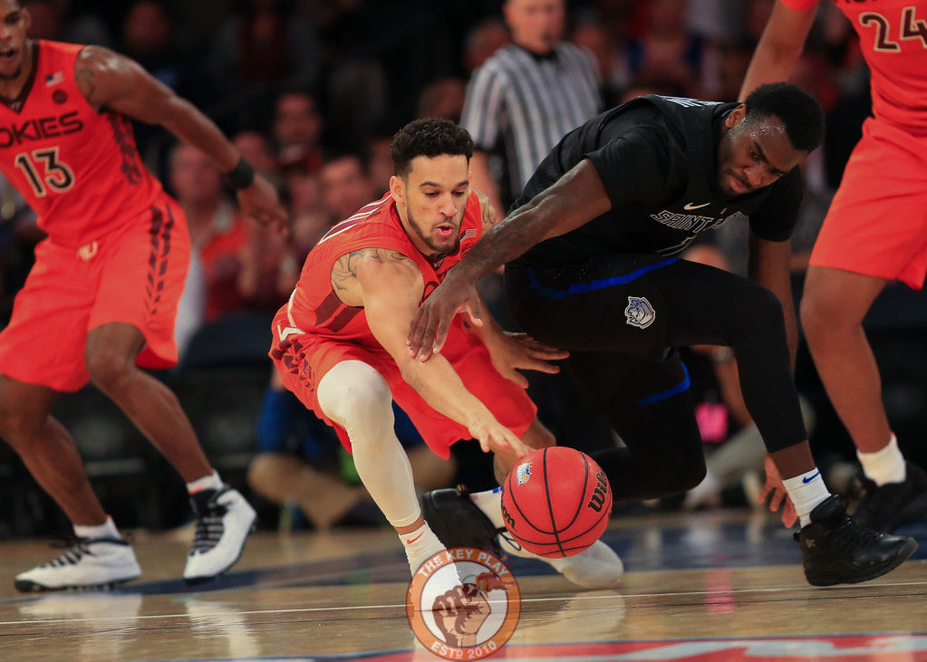 Virginia Tech's guard Devin Wilson (11) and St. Louis' guard Jordan Goodwin (0) fight for a loose ball in Madison Square Garde, Nov. 16, 2017. St. Louis upset Virginia Tech with a 77-71 win.