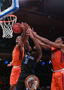 Virginia Tech's guard Nickeil Alexander-Walker (4) and guard Justin Bibbs (10) grab a rebound over St. Louis' guard Davell Roby (5) in Madison Square Garde, Nov. 16, 2017. St. Louis upset Virginia Tech with a 77-71 win.