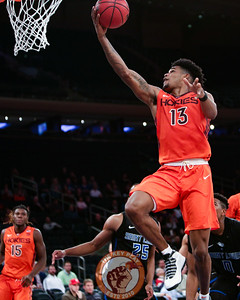 Virginia Tech's guard Ahmed Hill (13) goes for a lay up against St. Louis in Madison Square Garde, Nov. 16, 2017. St. Louis upset Virginia Tech with a 77-71 win.