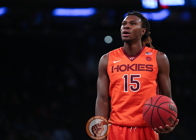 Virginia Tech's forward Chris Clarke (15) pauses before a free throw against St. Louis in Madison Square Garde, Nov. 16, 2017. St. Louis upset Virginia Tech with a 77-71 win.