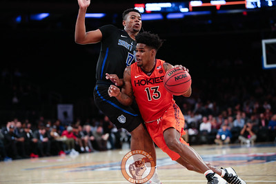 Virginia Tech's guard Ahmed Hill (13) dribbles around St. Louis' guard Jordan Goodwin (0) in Madison Square Garde, Nov. 16, 2017. St. Louis upset Virginia Tech with a 77-71 win.