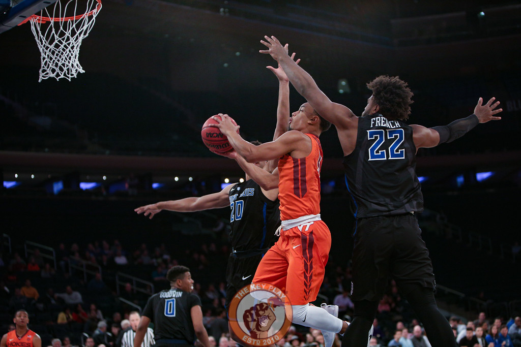 Virginia Tech's guard Justin Robinson (5) dodges between St. Louis' forward Jalen Johnson (20) and forward Hasahn French (22) in Madison Square Garde, Nov. 16, 2017. St. Louis upset Virginia Tech with a 77-71 win.