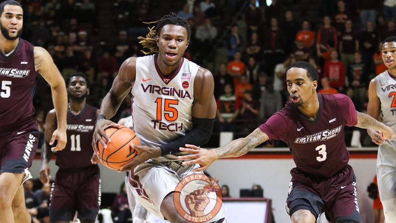 Chris Clarke keeps the ball away as he starts a layup attempt in the second half. (Mark Umansky/TheKeyPlay.com)