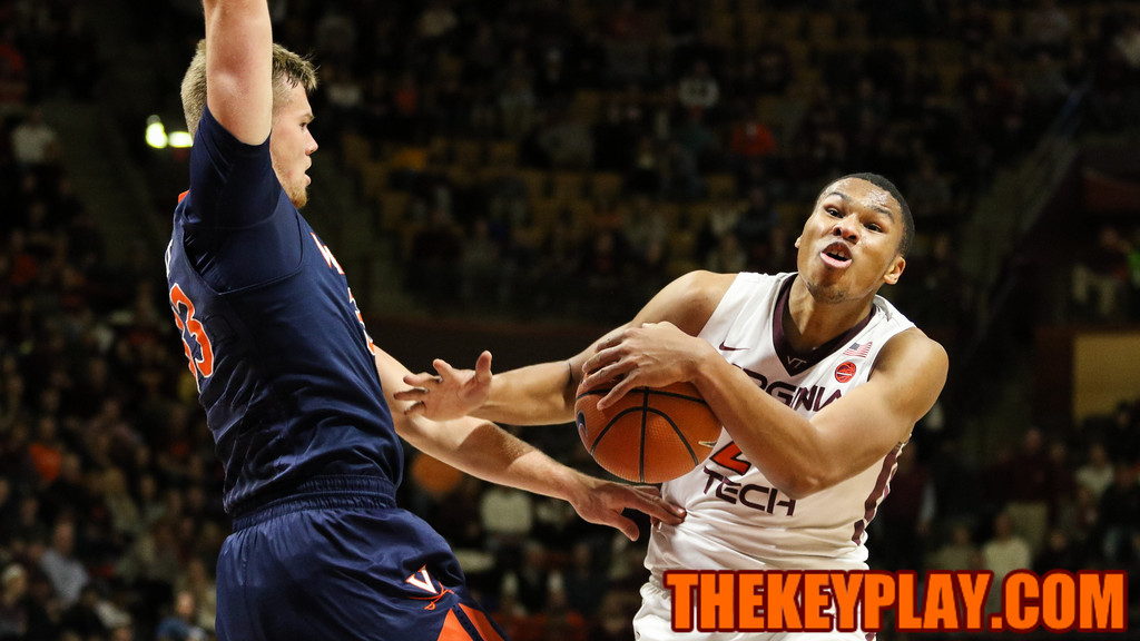 Kerry Blackshear Jr is fouled by UVA's Jack Salt in the first half. (Mark Umansky/TheKeyPlay.com)