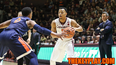 Justin Robinson dribbles the ball as he surveys the UVa defense (Mark Umansky/TheKeyPlay.com)