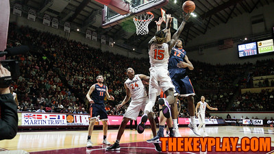 Chris Clarke is blocked on a layup attempt underneath the UVa basket in the first half. (Mark Umansky/TheKeyPlay.com)