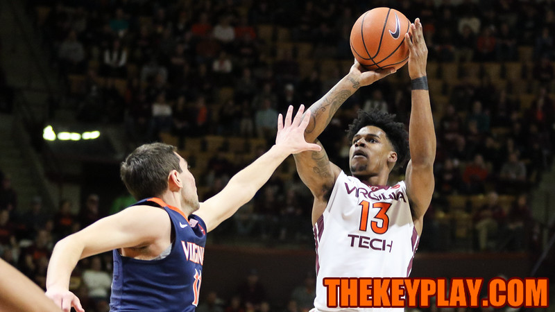 Ahmed Hill attempts a contested three point shot. (Mark Umansky/TheKeyPlay.com)