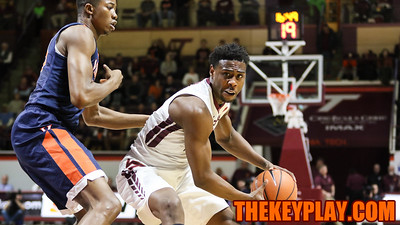 Justin Bibbs is heavily guarded on offense in the first half. (Mark Umansky/TheKeyPlay.com)