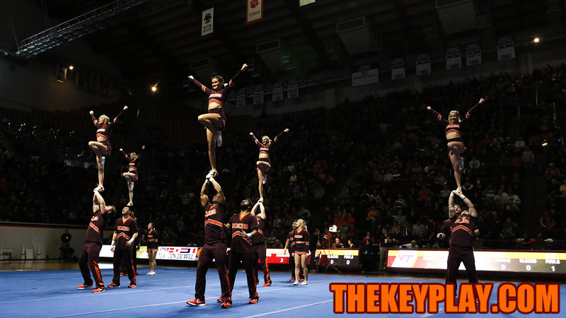 The Virginia Tech Cheerleading squad performs their national competition routine during halftime. (Mark Umansky/TheKeyPlay.com)