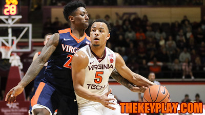 Justin Robinson dribbles the ball as UVa's Nigel Johnson attempts to poke the ball away from behind. (Mark Umansky/TheKeyPlay.com)