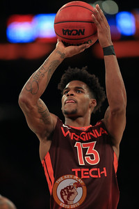 Virginia Tech's guard Ahmed Hill (13) shoots during play against Washington in Madison Square Garden, Nov. 17, 2017. Virginia Tech won the game 103-79.