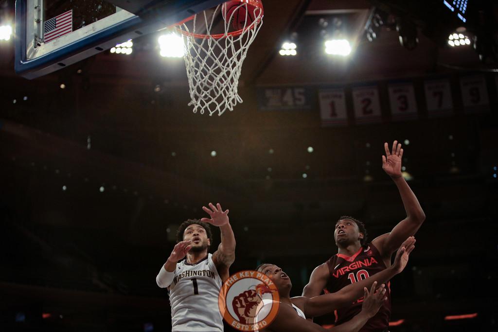 Virginia Tech's guard Justin Bibbs (10) and Washington's guard David Crisp (1) look for a rebound under the basket in Madison Square Garden, Nov. 17, 2017. Virginia Tech won the game 103-79.