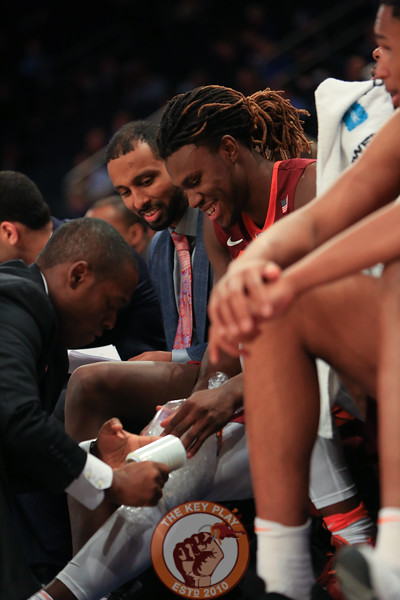 Virginia Tech's forward Chris Clarke (15) gets his leg taped during play against Washington in Madison Square Garden, Nov. 17, 2017. Virginia Tech won the game 103-79.