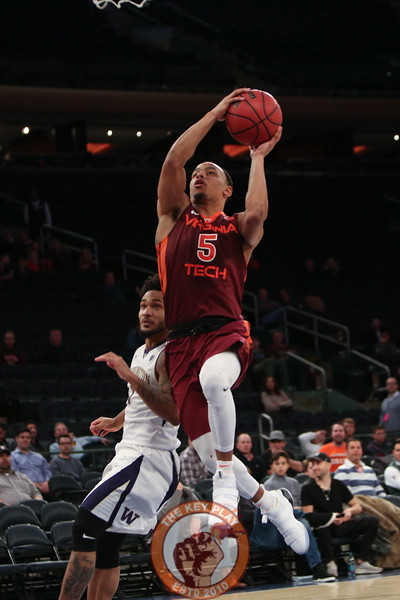 Virginia Tech's guard Justin Robinson (5) shoots against Washington in Madison Square Garden, Nov. 17, 2017. Virginia Tech won the game 103-79.