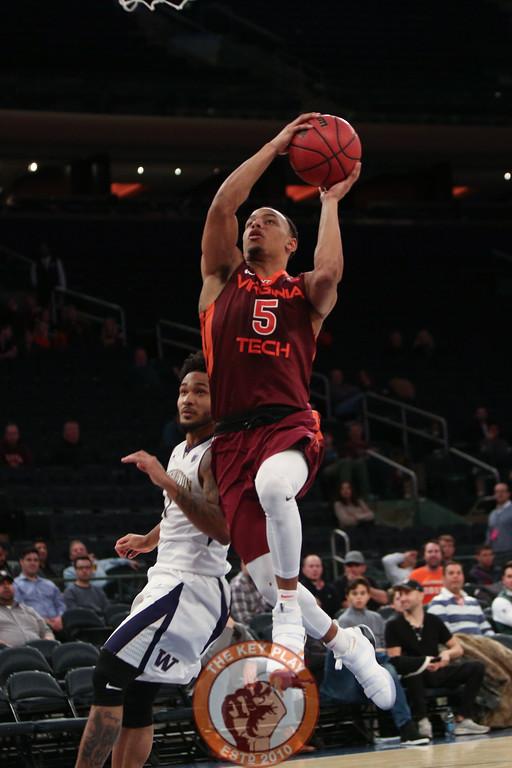 Virginia Tech's guard Justin Robinson (5) shoots against Washington in Madison Square Garden, Nov. 17, 2017. Virginia Tech won the game 103-79.