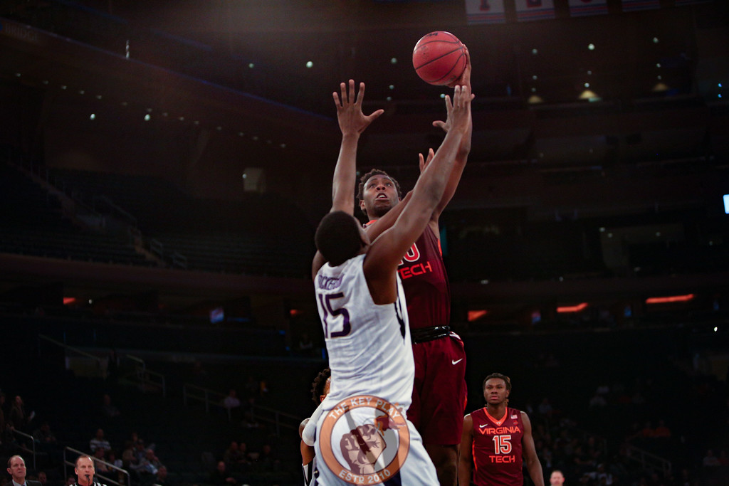 Virginia Tech's guard Justin Bibbs (10) shoots over Washington's forward Noah Dickerson (15) in Madison Square Garden, Nov. 17, 2017. Virginia Tech won the game 103-79.